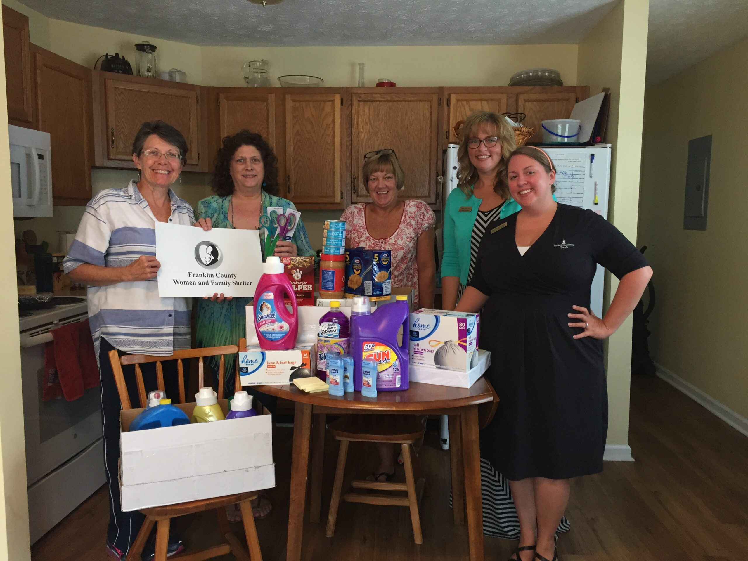 Holly Brunson standing inside of a kitchen donating items to Franklin County Womens Shelter