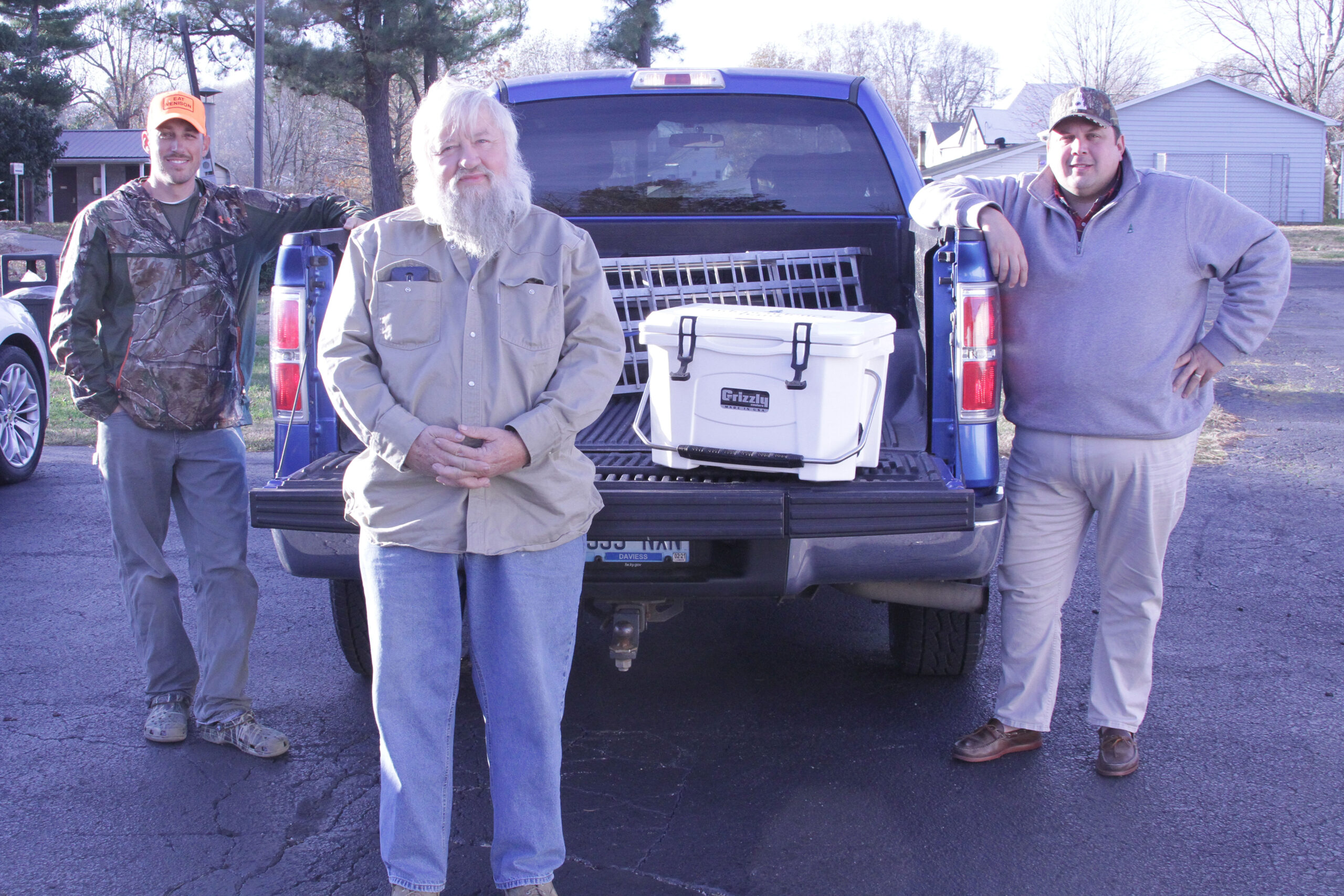 Chad Hall standing around a truck for Hunters for the Hungry initiative
